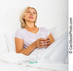 mature woman with pills