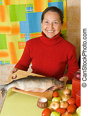 Mature woman with red fish