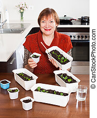 Mature woman with sprouts