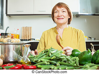 Mature woman with vegetables