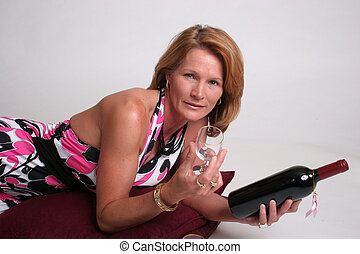Mature woman with wine