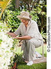 Mature woman working in her garden