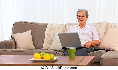 Mature woman working on her laptop