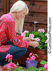 Mature woman working with flowers