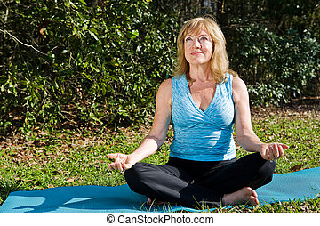 Mature Woman Yoga with Copyspace