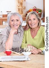 Mature women playing chess