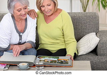 mature women skimming through family album