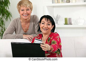 Mature women using a credit card online