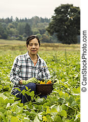 Mature women with green beans in basket