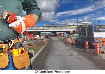 Mature worker and road repair. Repair work