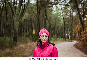 Matured woman in the forest