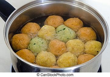 Matzah balls - Passover Food - Matzah balls in a pot of soup...