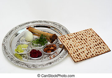 Matzo bread next to Passover Seder Plate with The seventh symbolic item used during the seder meal on passover Jewish holiday. White background with copy space