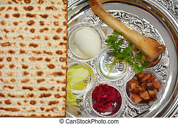 Matzo bread next to Passover Seder Plate with The seventh symbolic item used during the seder meal on passover Jewish holiday.