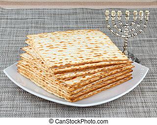 matzo - Matzo (or matzah) is bread traditionally eaten by...