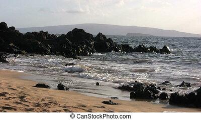 Maui Beach - waves coming ashore on a scenic maui beach