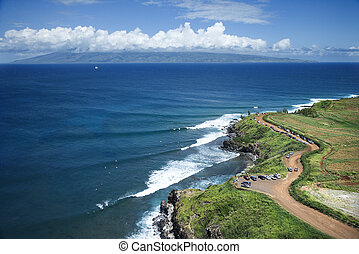 Maui coastline. - Aerial view of coastline with surfers and ...