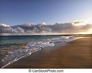 Maui Hawaii beach - Waves lapping on the beach at dusk in...
