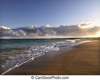 Maui Hawaii beach - Waves lapping on the beach at dusk in...