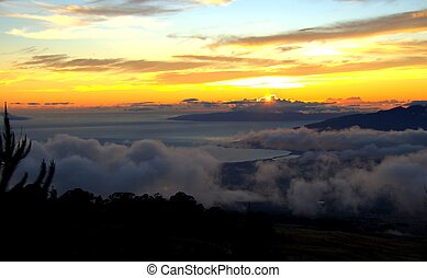 Maui Sunset with puffy clouds