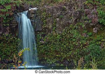 A beautiful tiered waterfall found on the road to Hana - Maui, Hawaii.