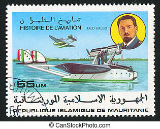 Italo Balbo and seaplanes - MAURITANIA - CIRCA 1977: stamp...