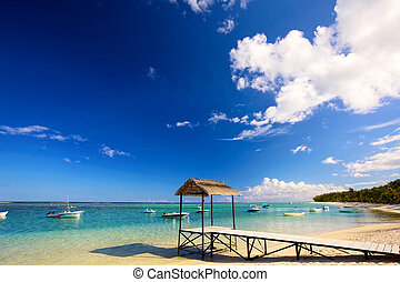 Mauritius beach - Calm scene with jetty, boats and turquoise...