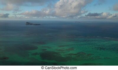 Mauritius island, view from a drone magnificent clouds and the Indian ocean.