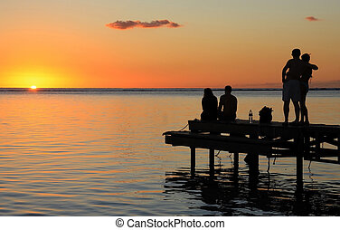 Mauritius sunset - Two couples are waiting sunset in...