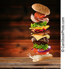 Maxi hamburger with flying ingredients