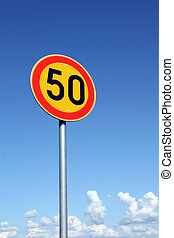 Maximum Speed 50 km per hour with bright sky background