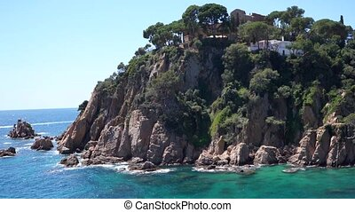 may, 2019, Spain, Costa Brava, medieval castle-fortress, sea trip view from the water