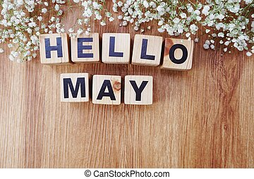 may alphabet letters on wooden background