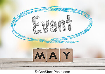 May event sign on a wooden table