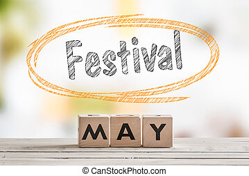 May festival sign on a wooden table