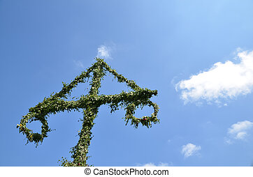 May pole , symbol for midsummer in Sweden, at a blue sky...