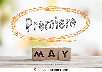 May premiere sign on a wooden table
