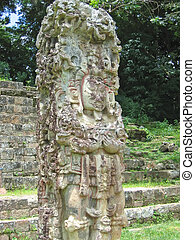 Maya deus stone statue with some coloured paint - Copan - ...