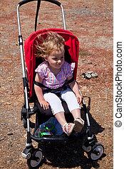 Maya in red stroller