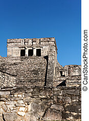 Mayan Architecture before a Clear Blue Sky at Tulum - Mayan...