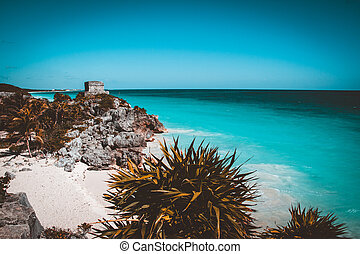 Mayan Temple of the Wind God in Tulum, Mexico. Teal and orange view
