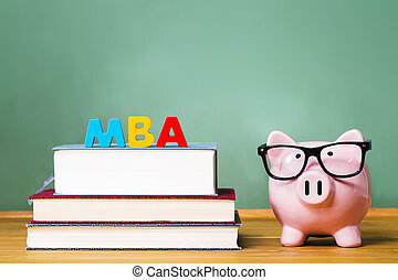 Master of Business Administration degree theme with textbooks and piggy bank and green chalkboard