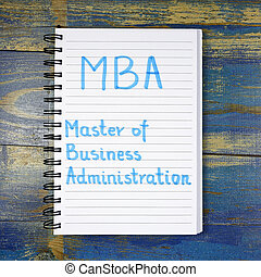 MBA- Master of Business Administration acronym written in notebook on wooden background