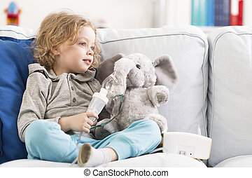 Me and my little elephant are ill... - Little child sitting...