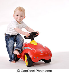 Me and my red car - Cute caucasian blond toddler ishappy and...