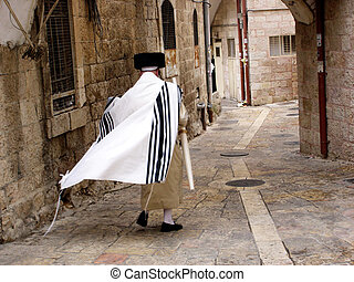 JERUSALEM - OCT 20:Orthodox Jewish man walks in Mea Shearim on October 20 2005 Jerusalem, Israel. It's one of the oldest Jewish neighborhoods in Jerusalem populated mainly by Haredi Jews.