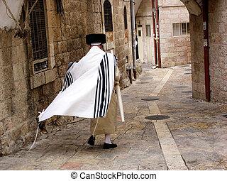 JERUSALEM - OCT 20:Orthodox Jewish man walks in Mea Shearim on October 20 2005 Jerusalem, Israel. It's one of the oldest Jewish neighborhoods in Jerusalem populated mainly by Haredi Jews.
