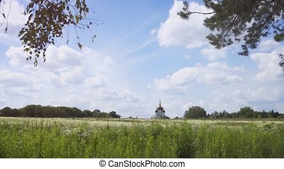 Picturesque domes and spires of Kiev-Pechersk Lavra, a historic Orthodox Church, presiding over a tranquil meadow in Ukraine. Ultra HD stock footage