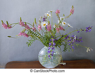 Meadow flowers in glass vase