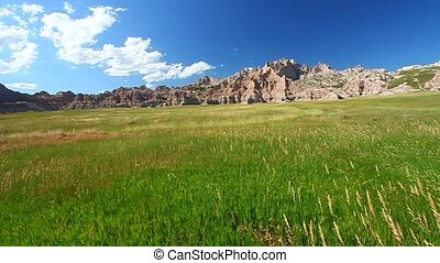 Badlands National Park - USA - Meadow grasses sway below the...